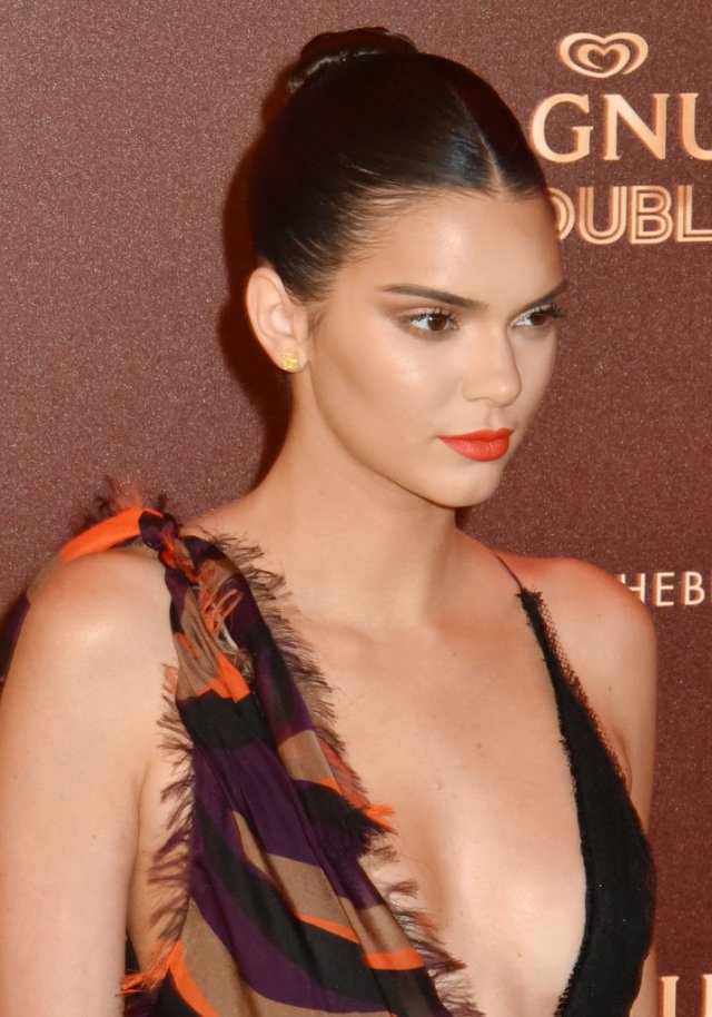 Kendall-Jenner-slicked-back-bun-red-lip-were-perfectly